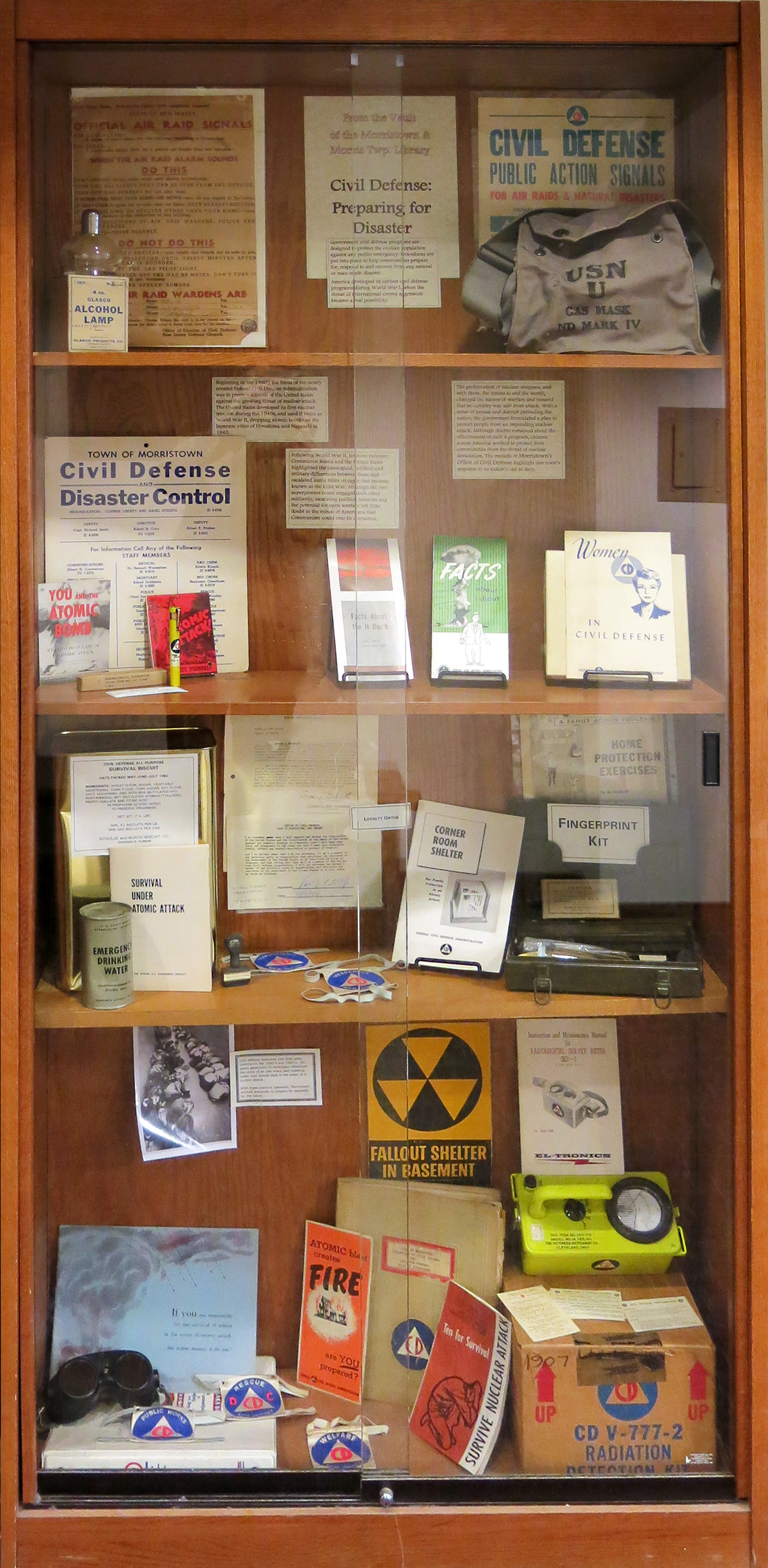 Display case with civil defense items