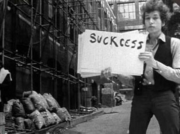 "Dylan in movie with ""suckcess"" sign"