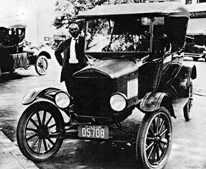 Matt Washington and his taxi, 1925