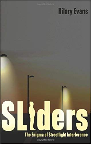 """Book cover for """"Sliders: The Enigma of Streetlight Interference"""""""