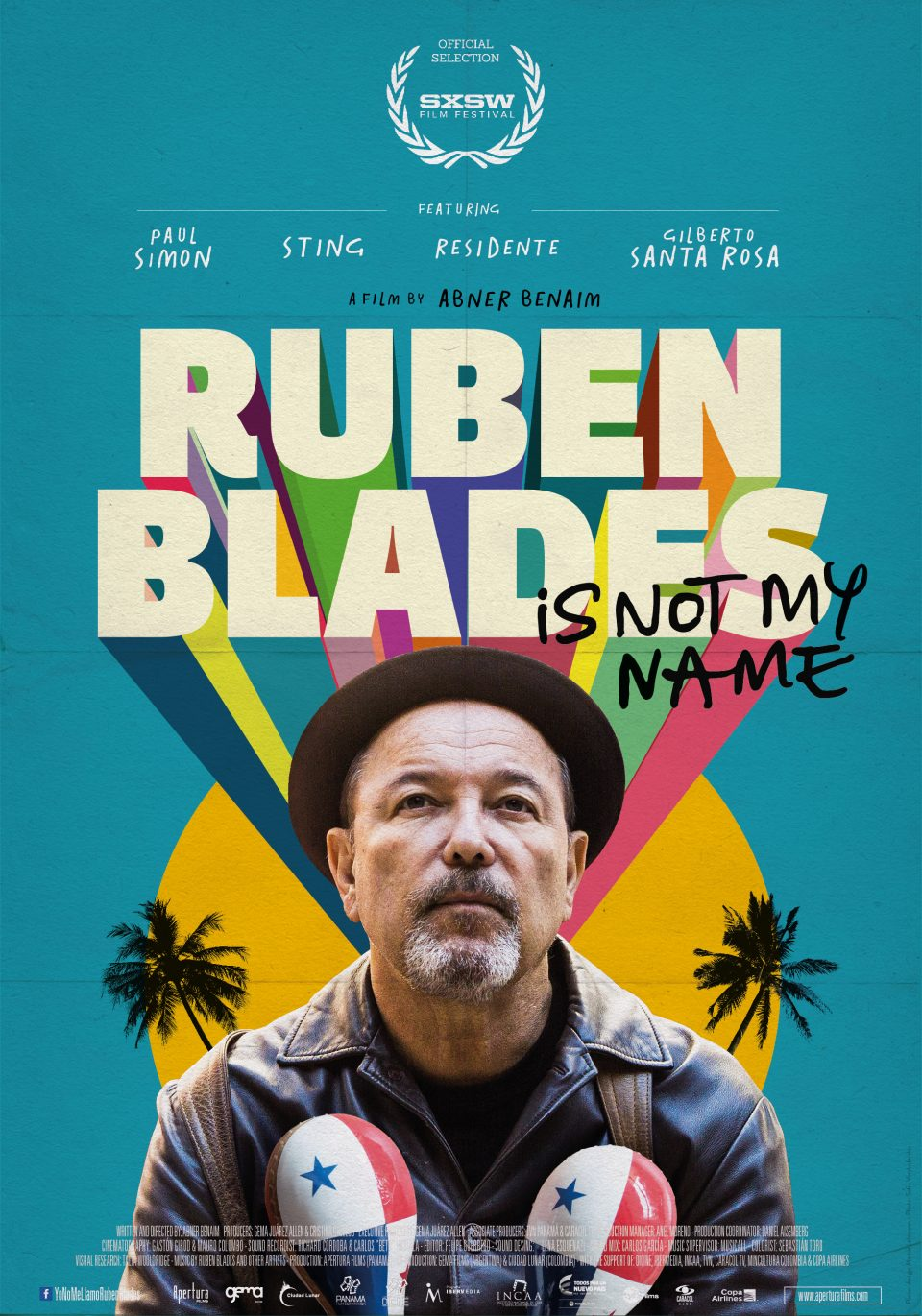 "Movie cover for ""Ruben Blades is not my name"" ; a man holding maracas in front of yellow and blue background."